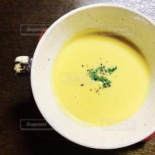 食品とコーヒーのカップのプレートの写真・画像素材[1559041]