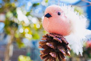 松ぼっくりと小鳥の人形 - No.1038497