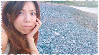 砂浜にいる女性の写真・画像素材[1291429]