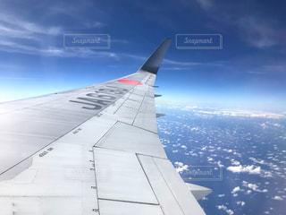 飛行機で移動中の写真・画像素材[1043184]