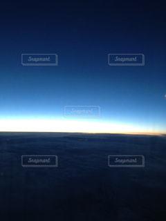 空からみる日没の写真・画像素材[1044524]