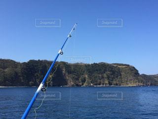 釣り竿と海の写真・画像素材[1058540]