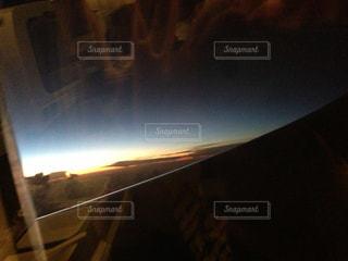 飛行機からの夕焼けの写真・画像素材[1052489]