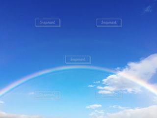 空に虹の写真・画像素材[1053430]