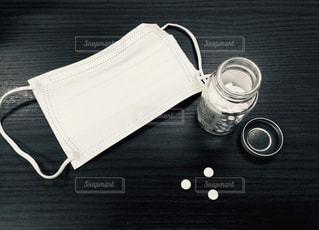 風邪薬とマスクの写真・画像素材[1506592]