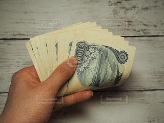 千円札10枚(一万円)の写真・画像素材[2038257]
