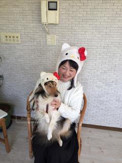 帽子をかぶった犬の写真・画像素材[1077232]
