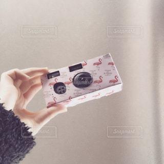 リモコンを持つ手の写真・画像素材[957995]