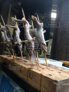 魚の串焼きの写真・画像素材[1083438]