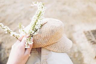 花と帽子の写真・画像素材[1086739]
