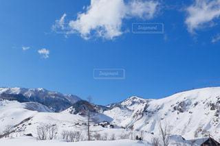 快晴の雪山の写真・画像素材[1101898]