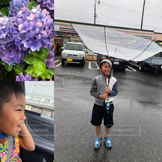 駐車場に立っている女の子の写真・画像素材[1249477]