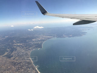 飛んでいる飛行機の中から撮った写真の写真・画像素材[1109223]