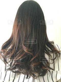私の後ろ姿。巻き髪。の写真・画像素材[1129014]