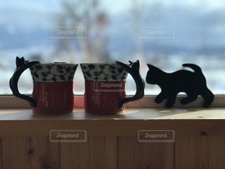 ネコのコーヒーカップの写真・画像素材[1547802]