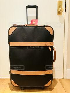スーツケースとパスポートの写真・画像素材[1187111]