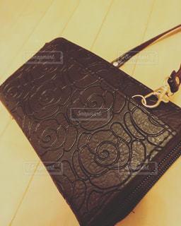 黒のお財布バッグの写真・画像素材[1140809]