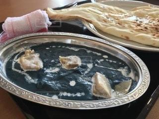 板の上に食べ物のパンの写真・画像素材[1169466]