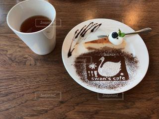 テーブルの上のコーヒー カップの写真・画像素材[1162269]
