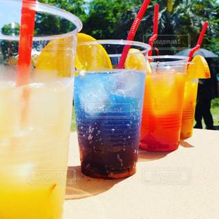 オレンジ ジュースのガラスの写真・画像素材[1170540]
