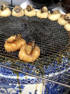 宮島で出逢った牡蠣おにぎりの写真・画像素材[1173126]