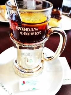テーブルの上のコーヒー カップの写真・画像素材[1248784]