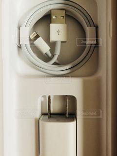 スマホの充電器の写真・画像素材[1322467]