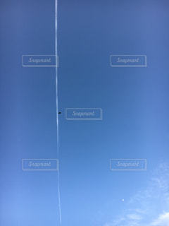 飛行機雲の写真・画像素材[1203080]