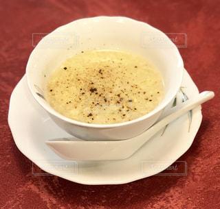 テーブルの上のコーヒー カップの写真・画像素材[1207798]