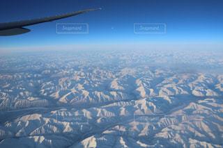 大型航空機を空中に高く飛ぶの写真・画像素材[1222775]