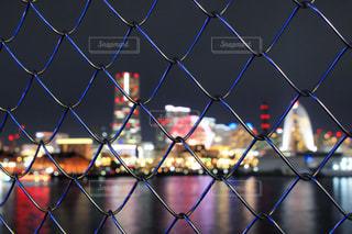フェンス越しの横浜の写真・画像素材[1392978]