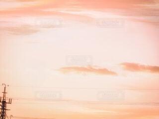 夕焼けと鉄塔の写真・画像素材[3819885]