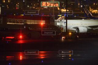 羽田空港と787とポンジュースの看板の写真・画像素材[1276198]