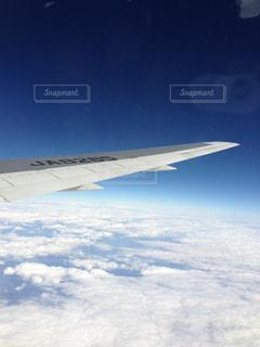 雲と飛行機の写真・画像素材[1281467]