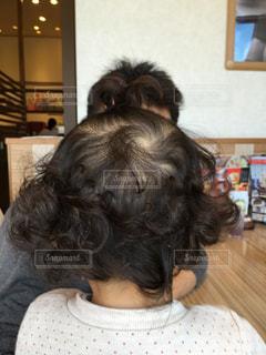 髪の毛くるくる後ろ姿の写真・画像素材[1346862]