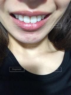 女性の口元のアップの写真・画像素材[1598552]