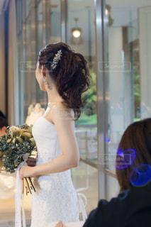 披露宴 ウェディングドレスとポニーテールの写真・画像素材[1606672]