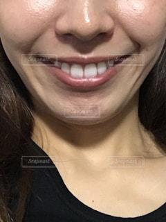 女性の口元のアップの写真・画像素材[1617995]