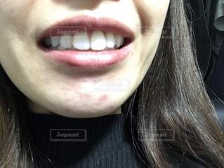 女性の口元の写真・画像素材[1629901]