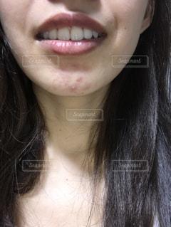 女性の口元のアップの写真・画像素材[1649979]