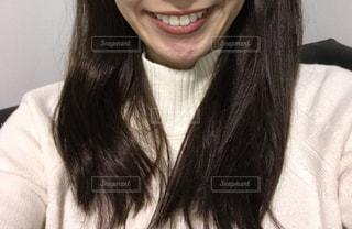 女性の口元の写真・画像素材[1668057]