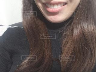 女性の口元の写真・画像素材[1703280]