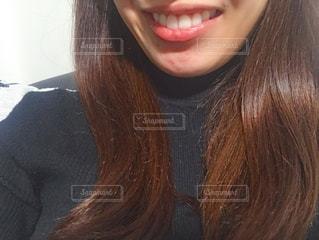 女性の口元の写真・画像素材[1703281]