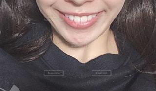 20代の女性の口元の写真・画像素材[1742726]