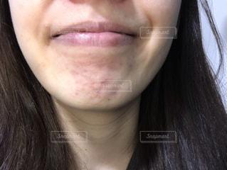 女性の口元の写真・画像素材[1848454]