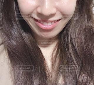 20代女性の口元の写真・画像素材[1848457]
