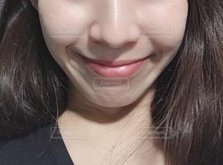 女性の口元のアップの写真・画像素材[1854726]