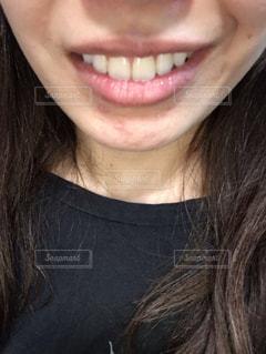女性の口元の写真・画像素材[2261245]