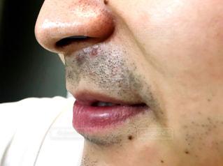 口を開けた男のクローズアップの写真・画像素材[2324143]