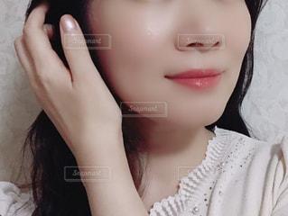 近くの女性のアップの写真・画像素材[1396810]
